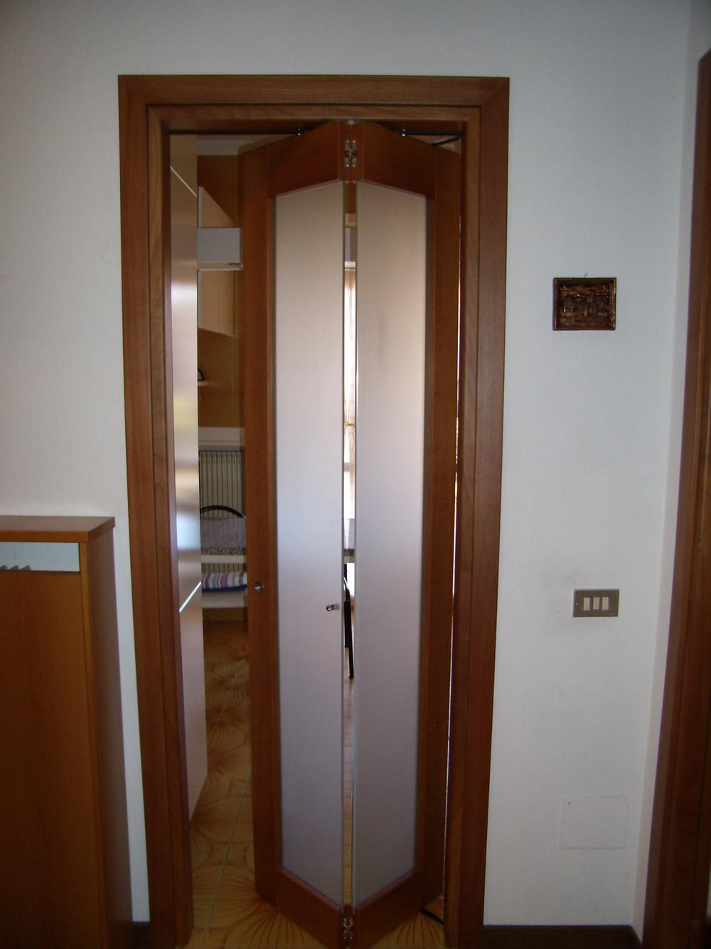 Porte roncoroni legno for Porte a libro economiche